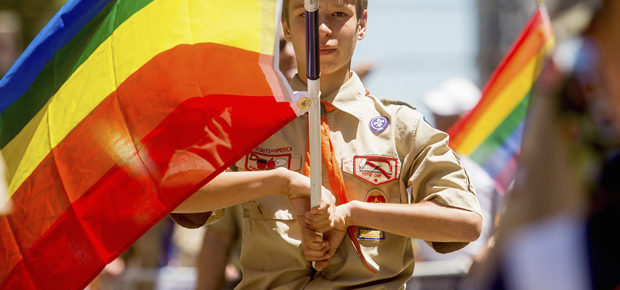 Boy Scout Casey Chambers carries a rainbow flag during the San Francisco Gay Pride Festival in California